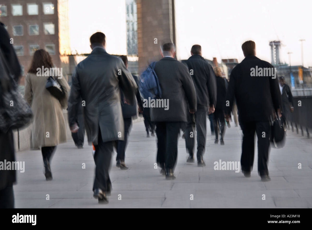 crowds of people commuters on London Bridge walking to work - Stock Image