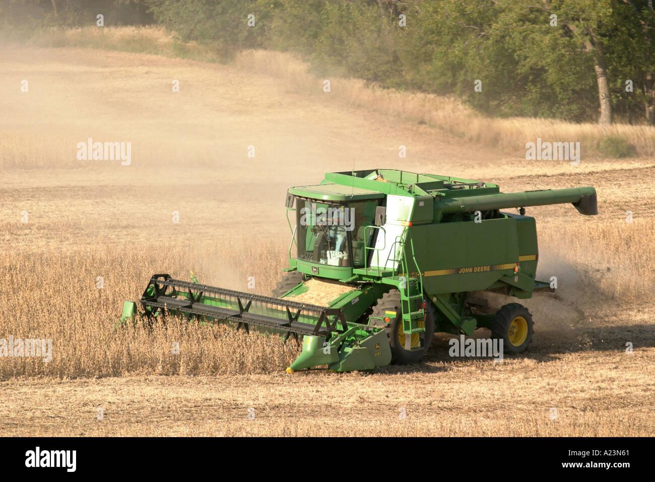John Deere Combine Harvesting In A Soybean Field