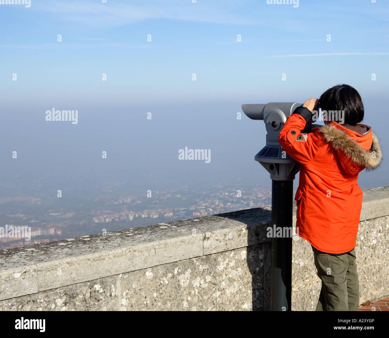 Boy with telescope, San Marino, Emilia-Romagna, Italy. - Stock Image