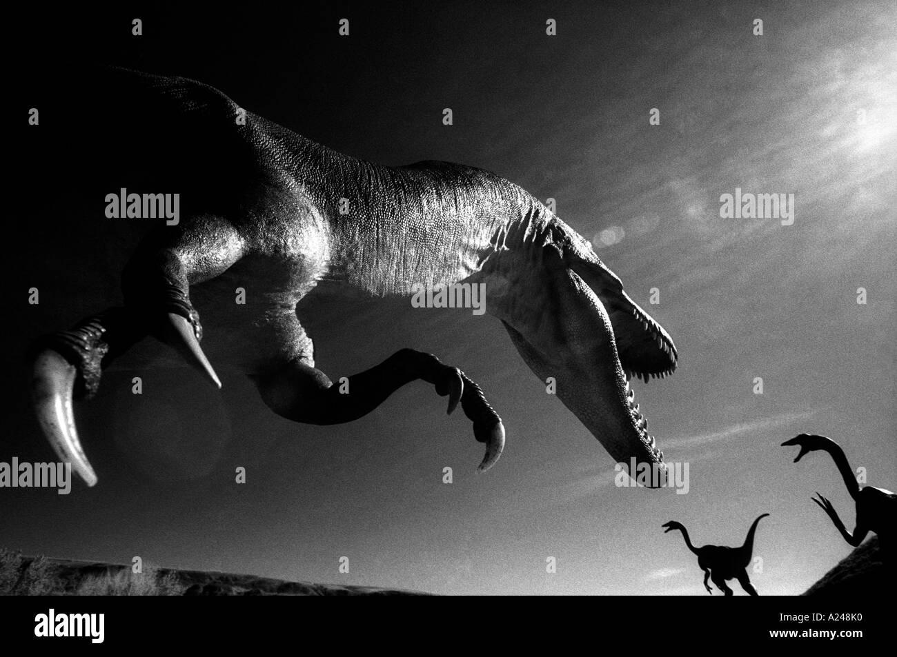 Dinosaur attacking fleeing prey. Models - Stock Image
