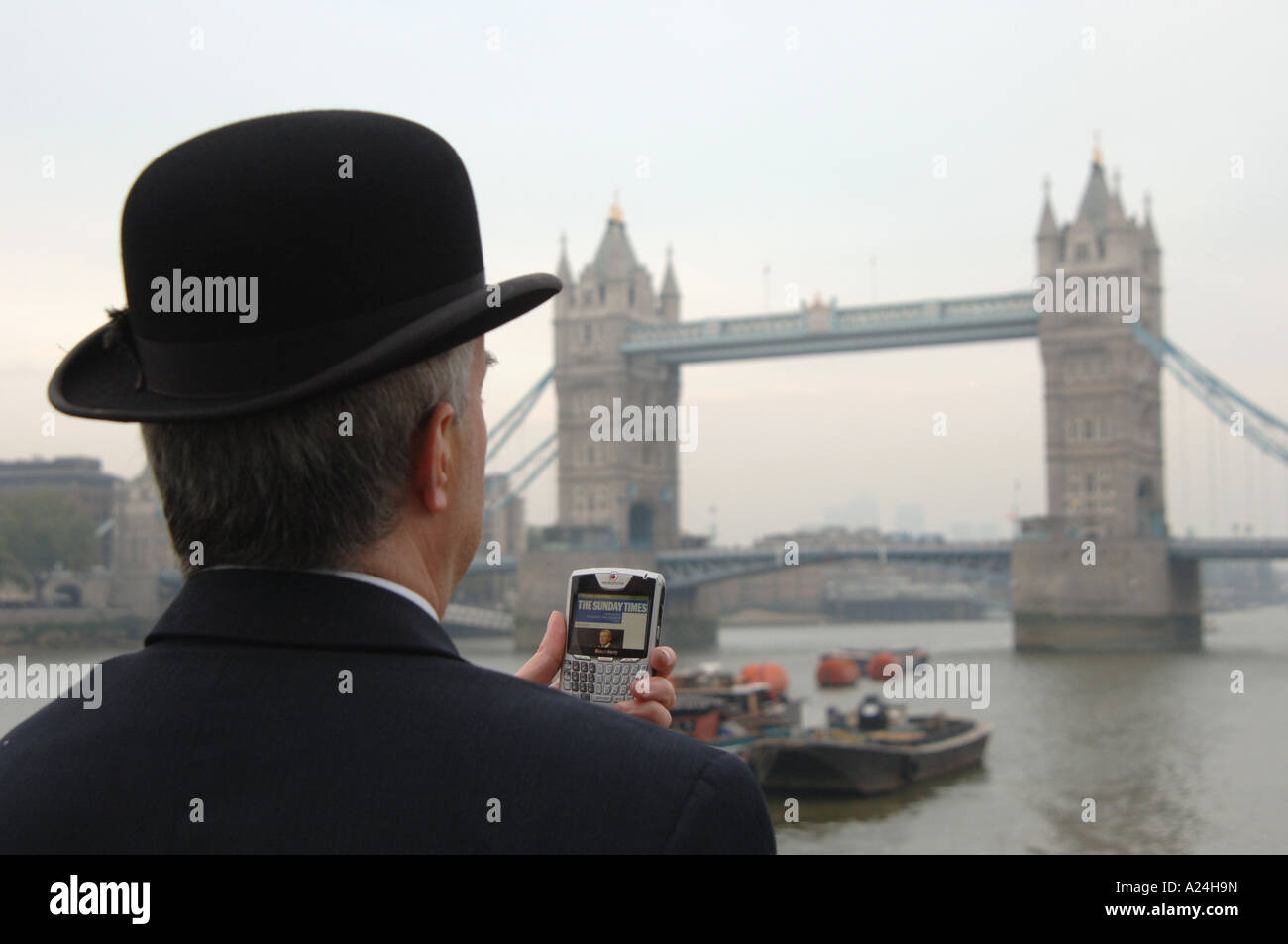 City gent with Blackberry smartphone - Stock Image