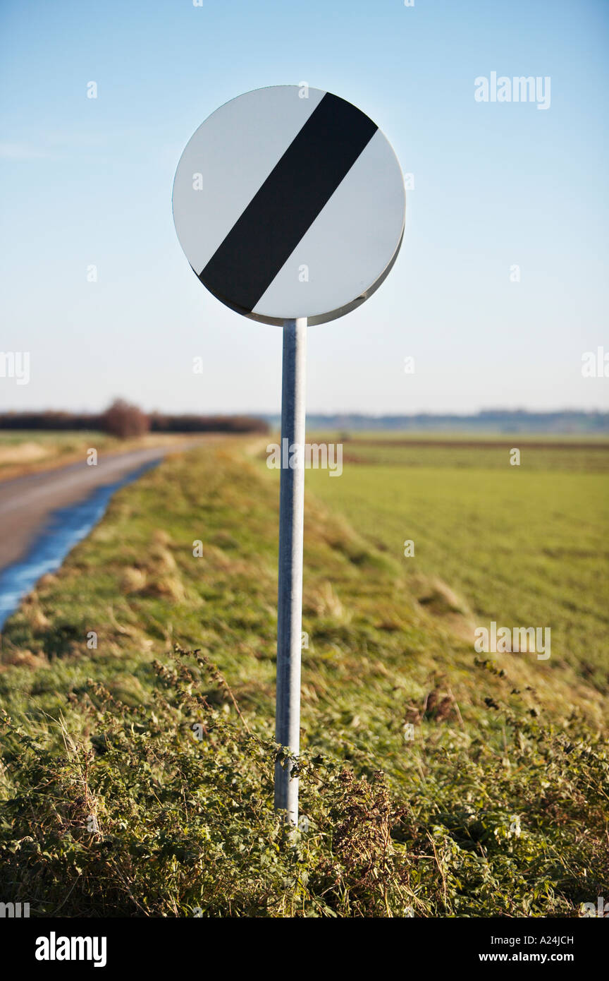 National speed limit traffic sign UK on open countryside road, England - Stock Image