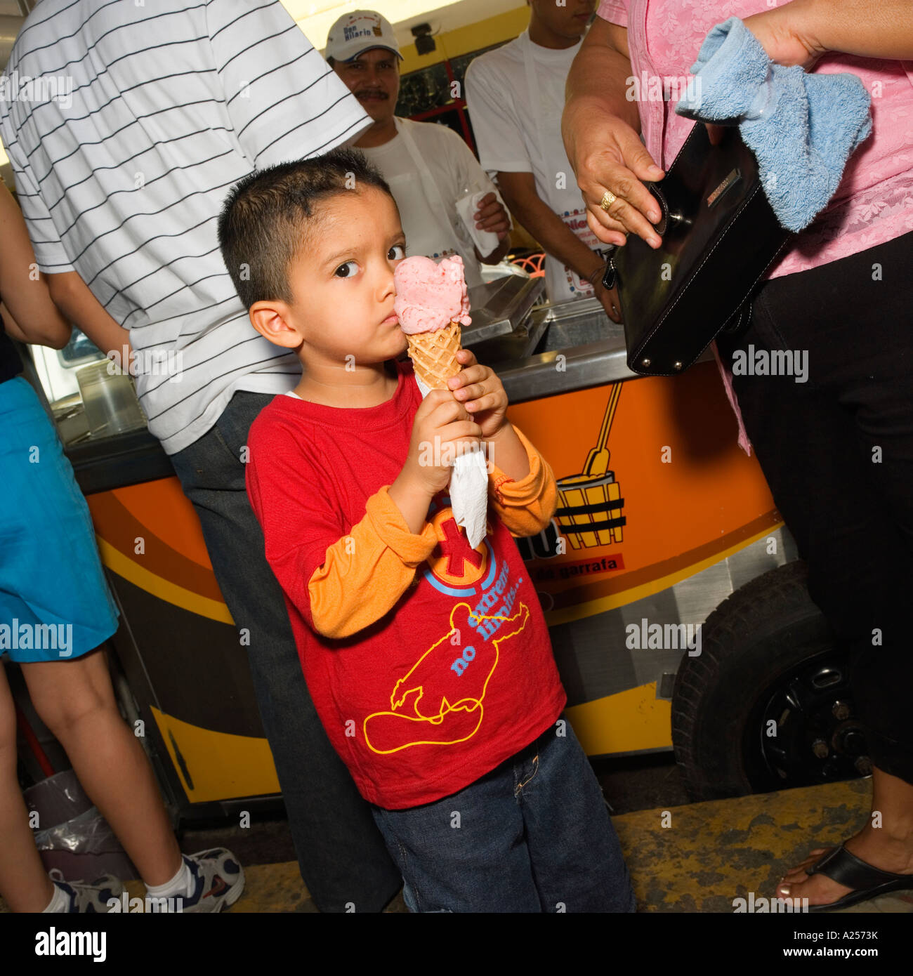 Boy eating ice-cream on the streets of downtown Mazatlan Mexico - Stock Image