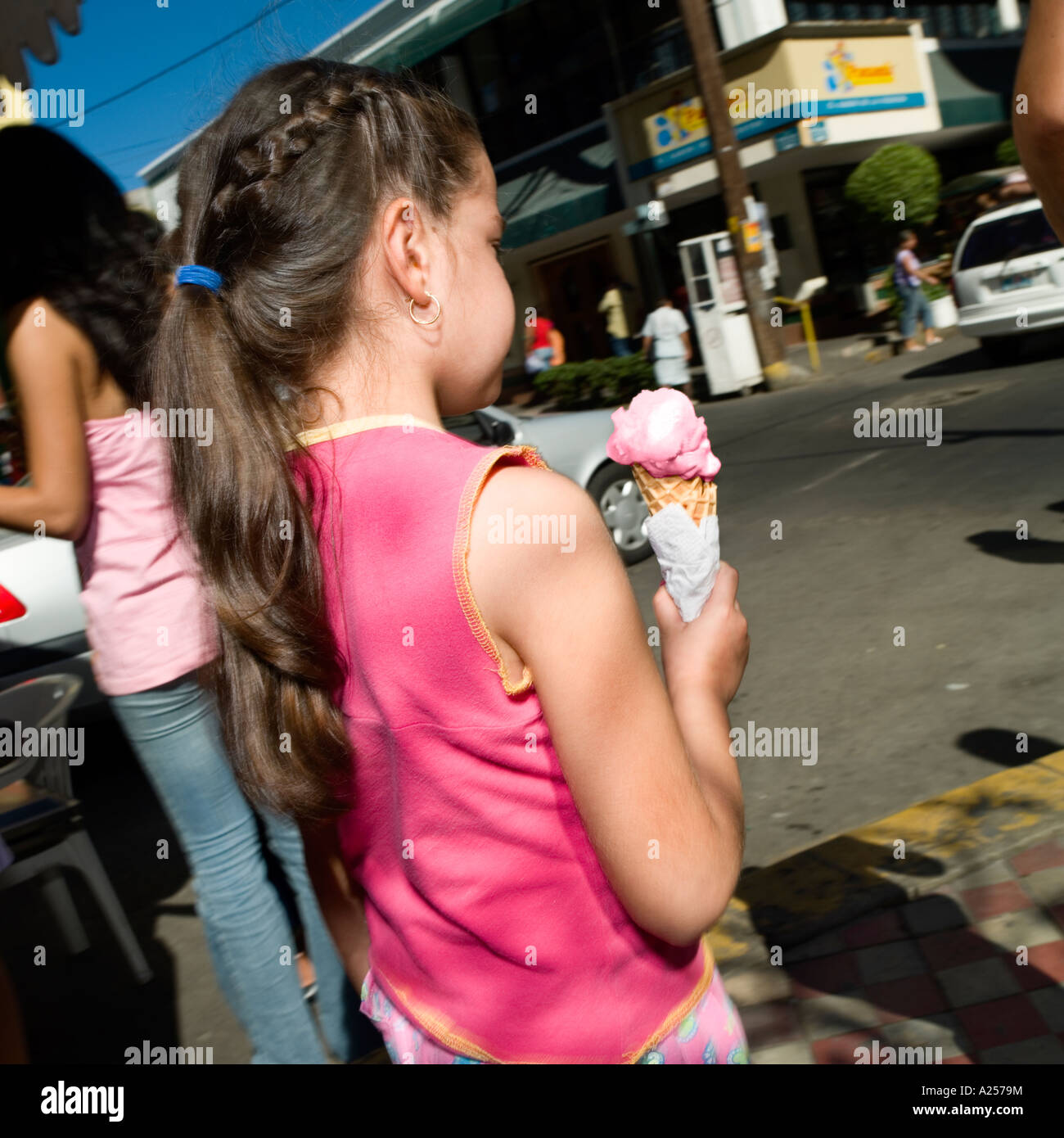 Girl eating ice-cream on the streets of Mazatlan Mexico - Stock Image