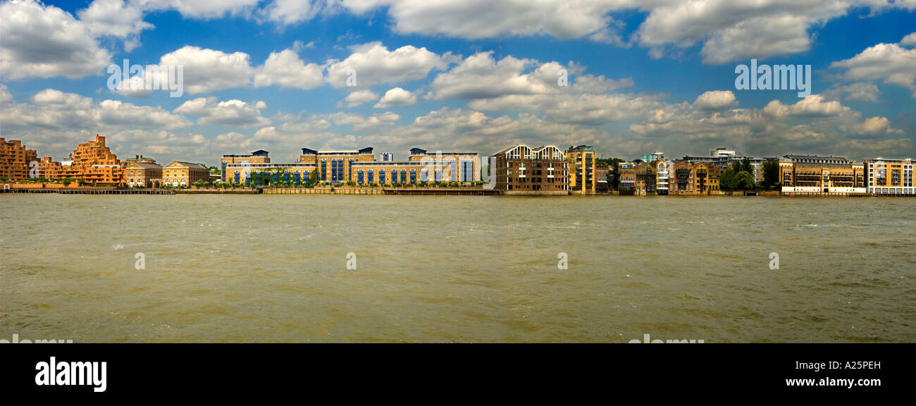 narrow street E14 from across river thames on sunny day london england uk - Stock Image