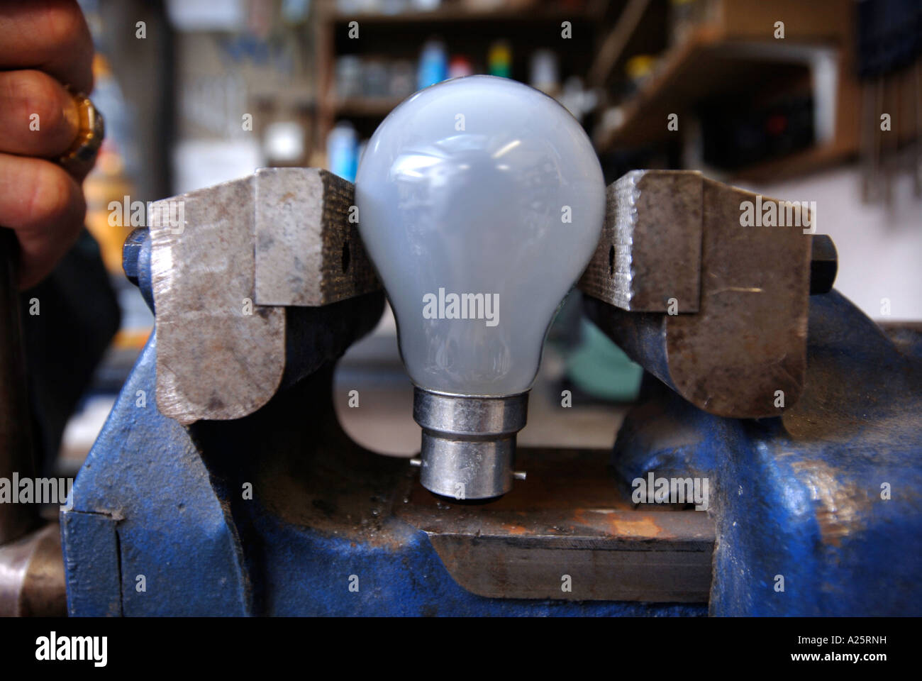 AN ELECTRICAL SHOP WORKSHOP WITH A LIGHT BULB IN A VICE UK Stock Photo