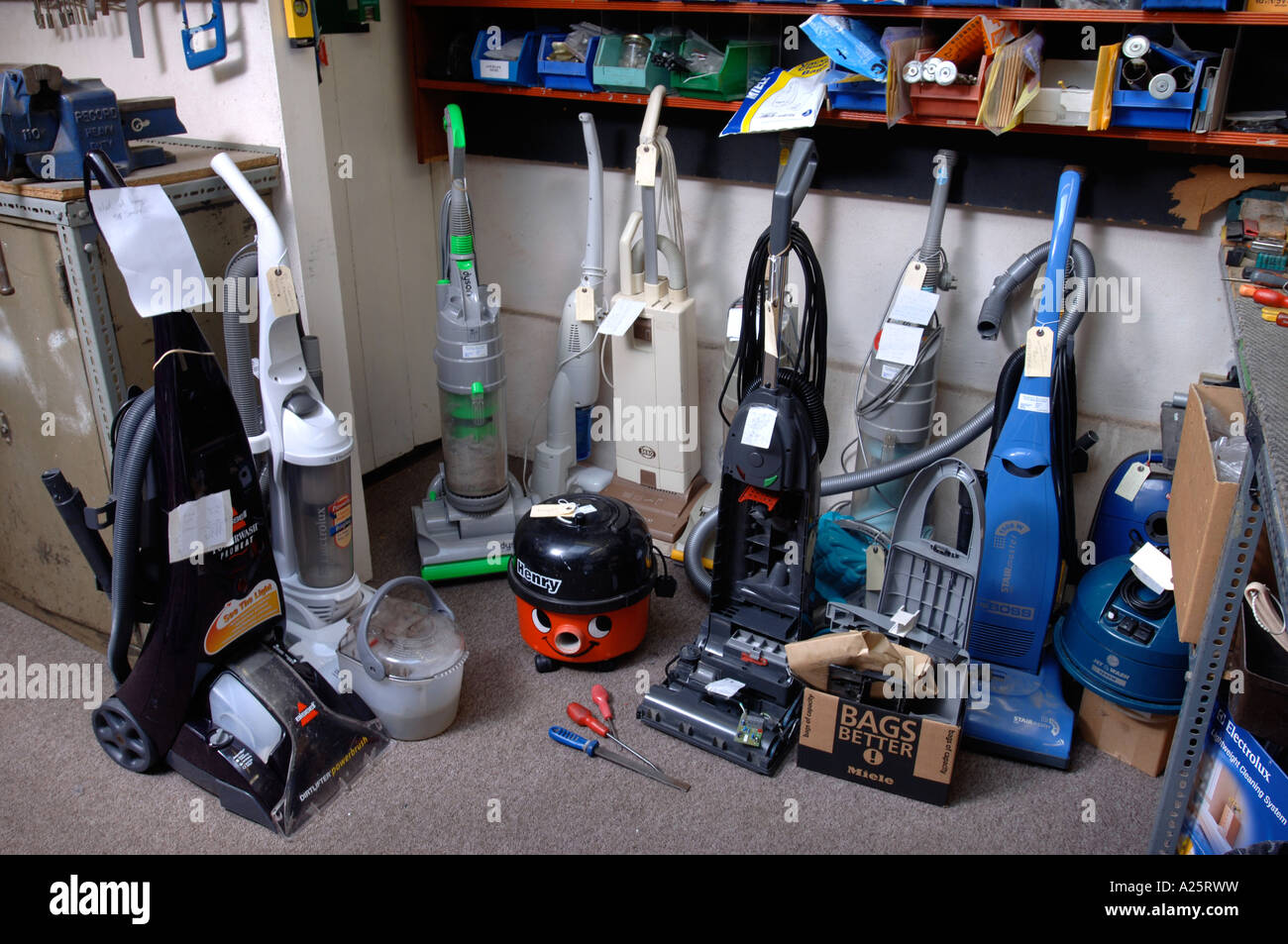 Awesome VACUUM CLEANERS AWAITING REPAIR IN A WORKSHOP UK