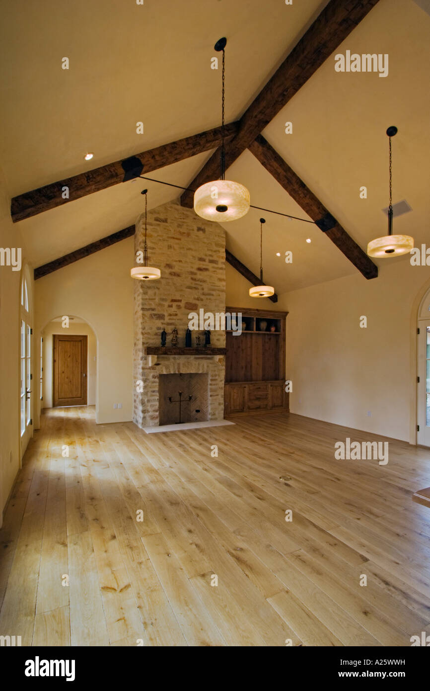 Hard Wood Floor Stone Fireplace Cabinets Open Beam Ceiling Light Fixtures In A Living Room California Luxury Home Stock Photo Alamy