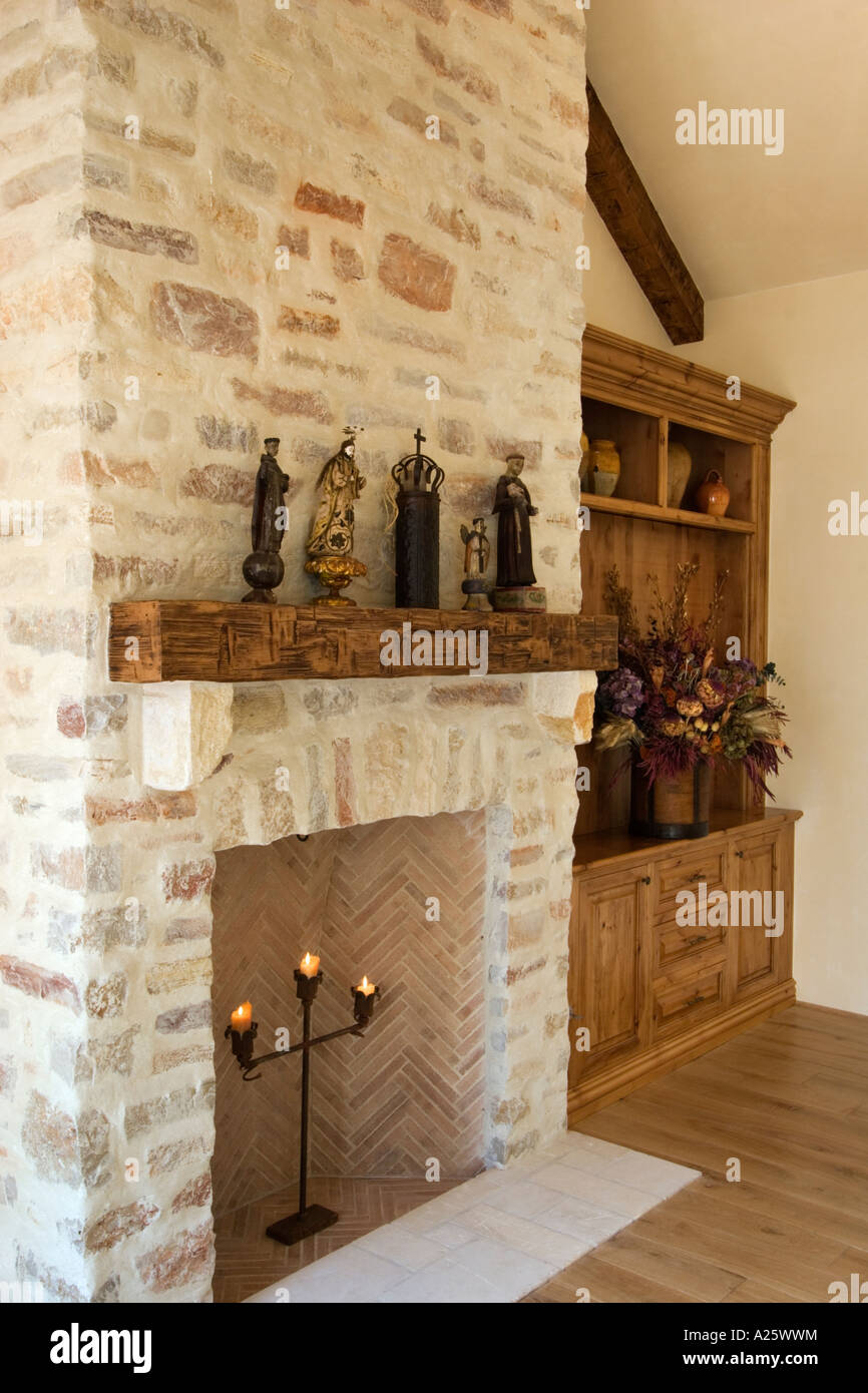 Hard Wood Floor Stone Fireplace Built In Cabinets And Statuary In A