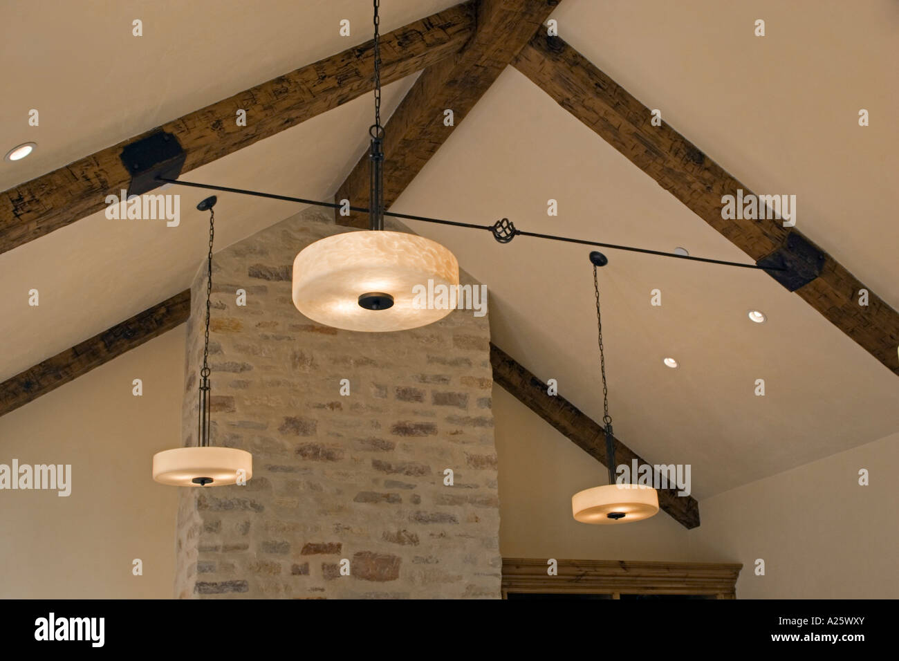 a wrought iron turnbuckle and open beam ceiling with contemporary lighting fixtures in a california luxury home - Open Beam Ceiling