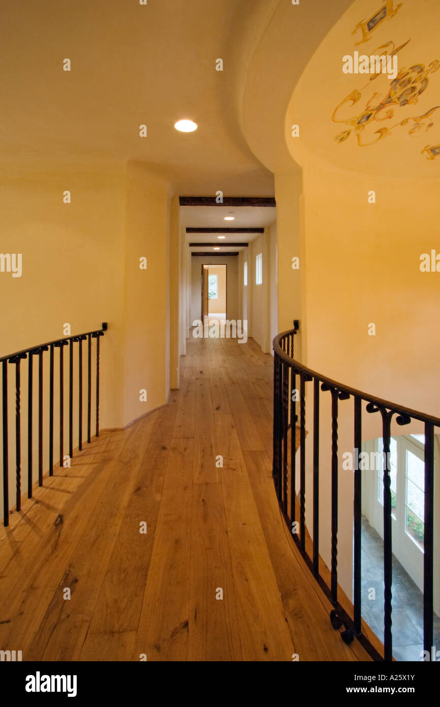 Hardwood Floor And Wrought Iron Railing In The Upstairs