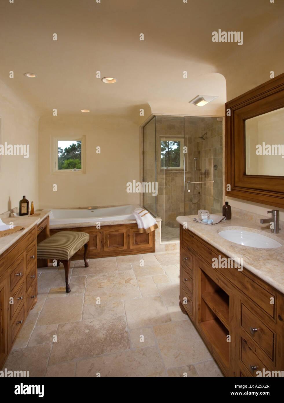 Stone floor sink shower stall and bathtub in a CALIFORNIA LUXURY ...