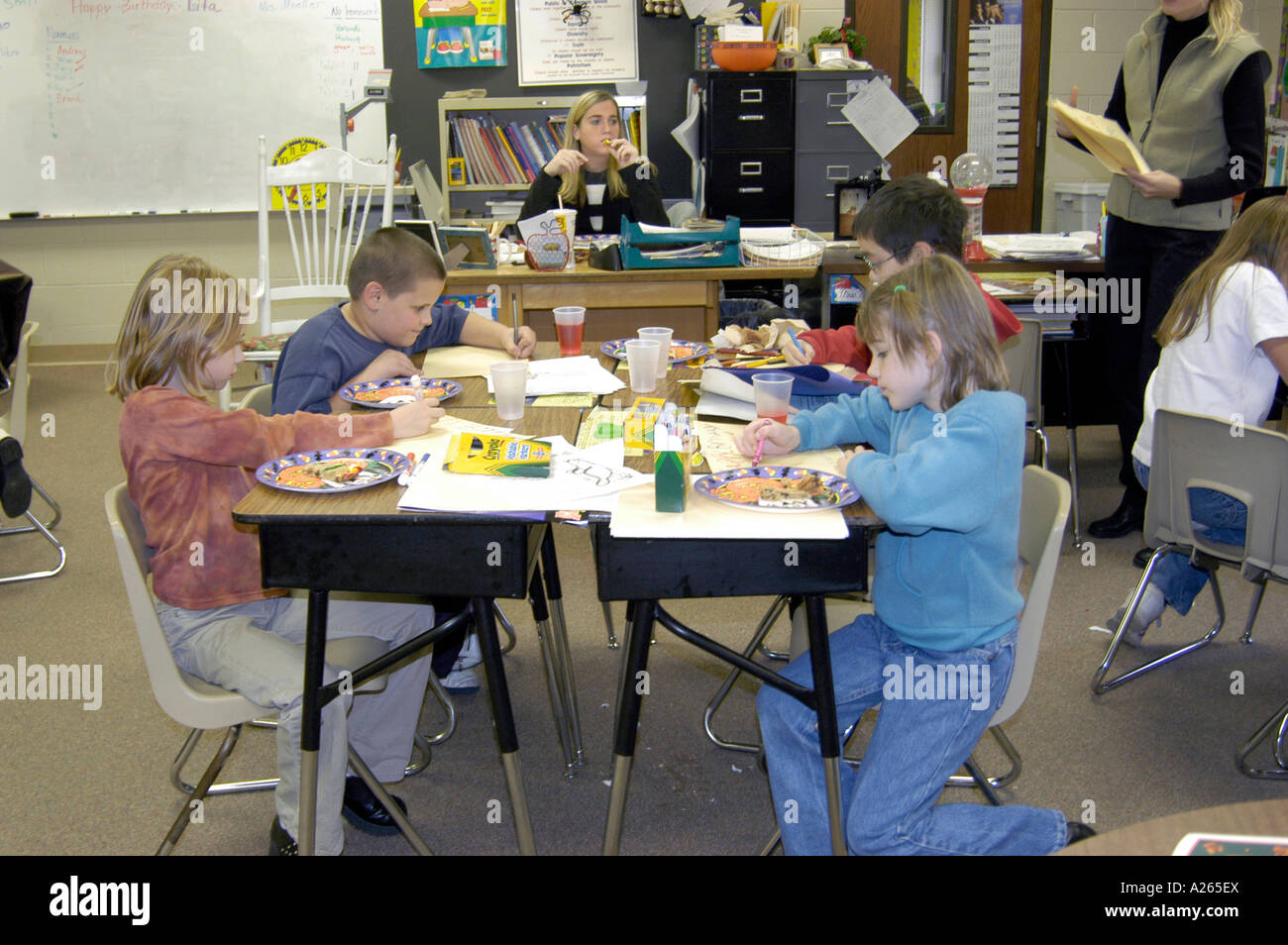 3rd grade elementary students working in group Stock Photo