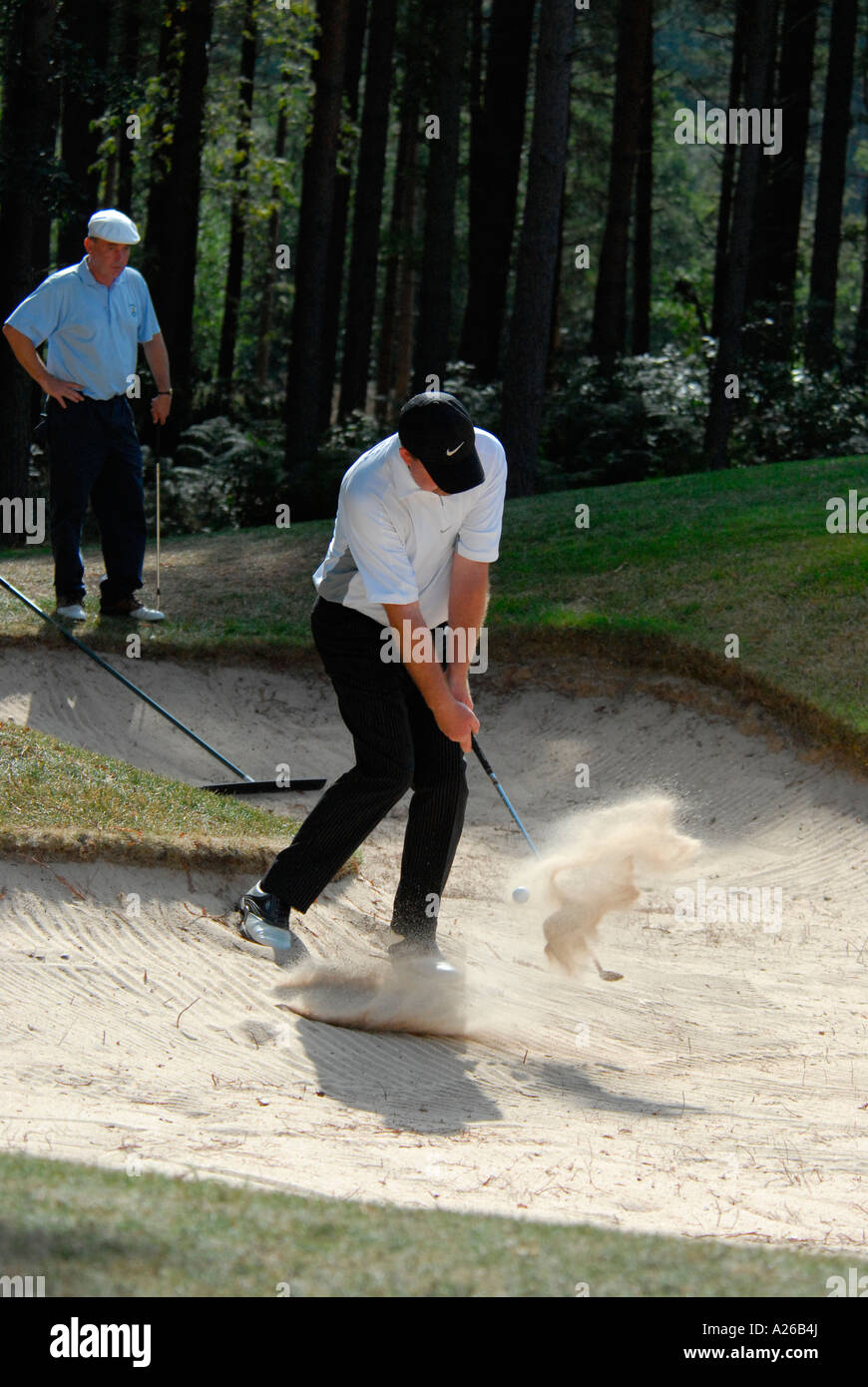 A player hits the ball in a sand bunker at a Pro am one day golf tournament,England,U.K,Britain - Stock Image