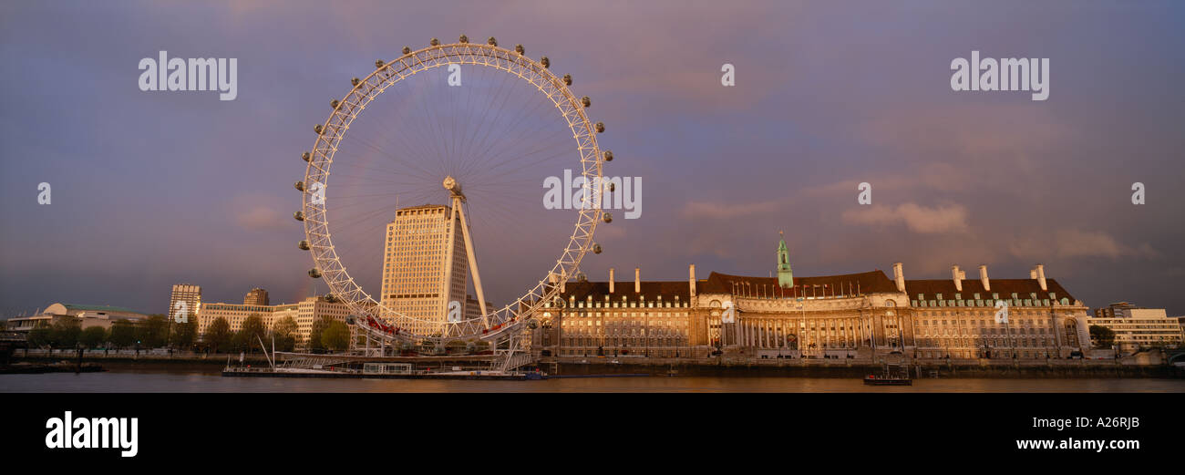 London skyline with the London Eye and GLC HQ Town Hall alongside the river Thames England UK - Stock Image