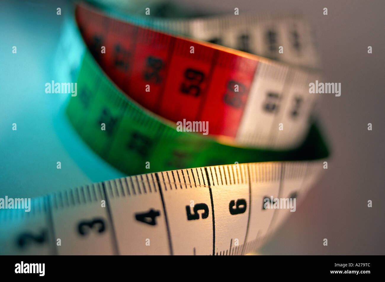 still life stilllife of a tapeline tape measure in red white and green Stock Photo