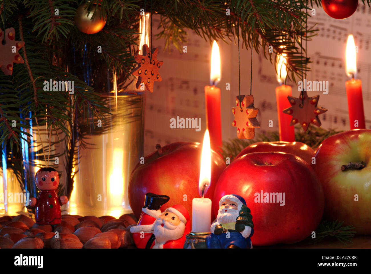 burning candles red apples nuts christmas decoration santa claus branches of - Christmas Background Music
