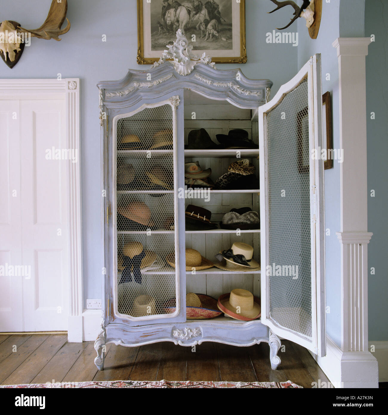 Hat collection in old French wardrobe - Stock Image