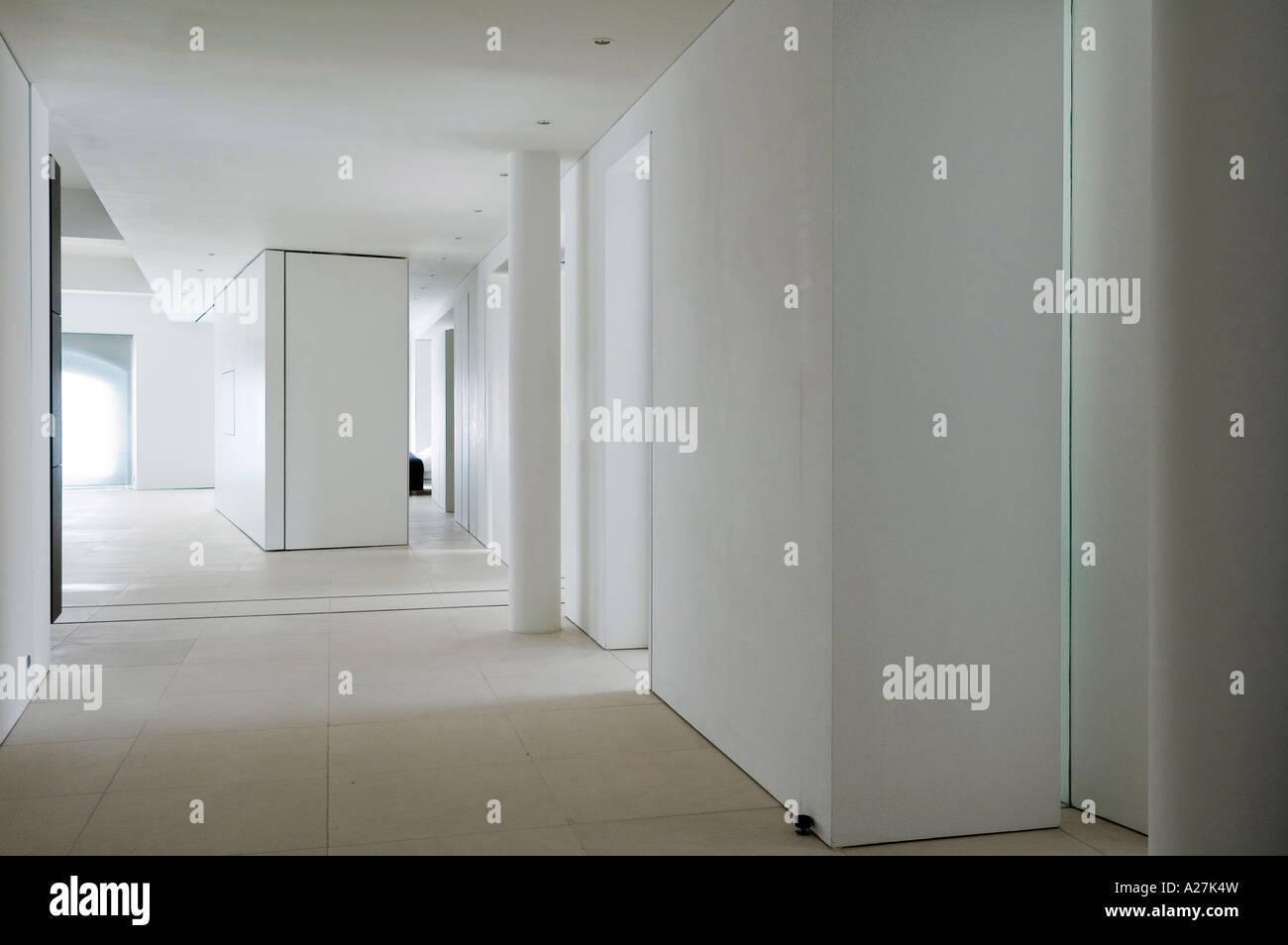 Hallway in minimalist warehouse conversion - Stock Image