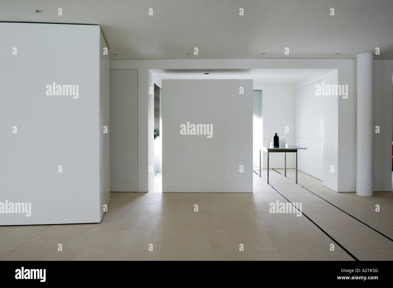 Interior of minimalist warehouse conversion with concealed screening - Stock Image