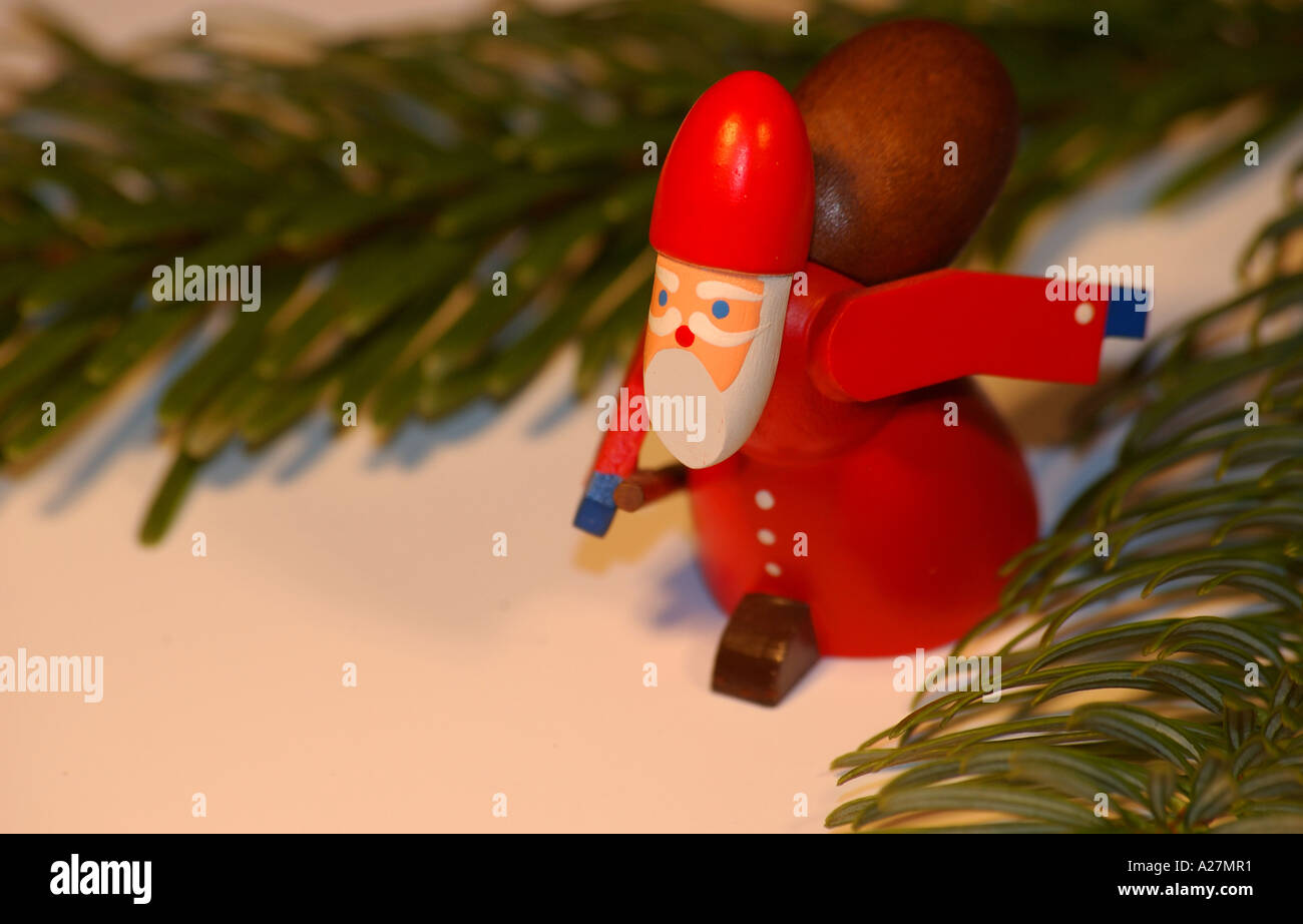 Wood-carved Santa Claus Christmas ornament - Stock Image