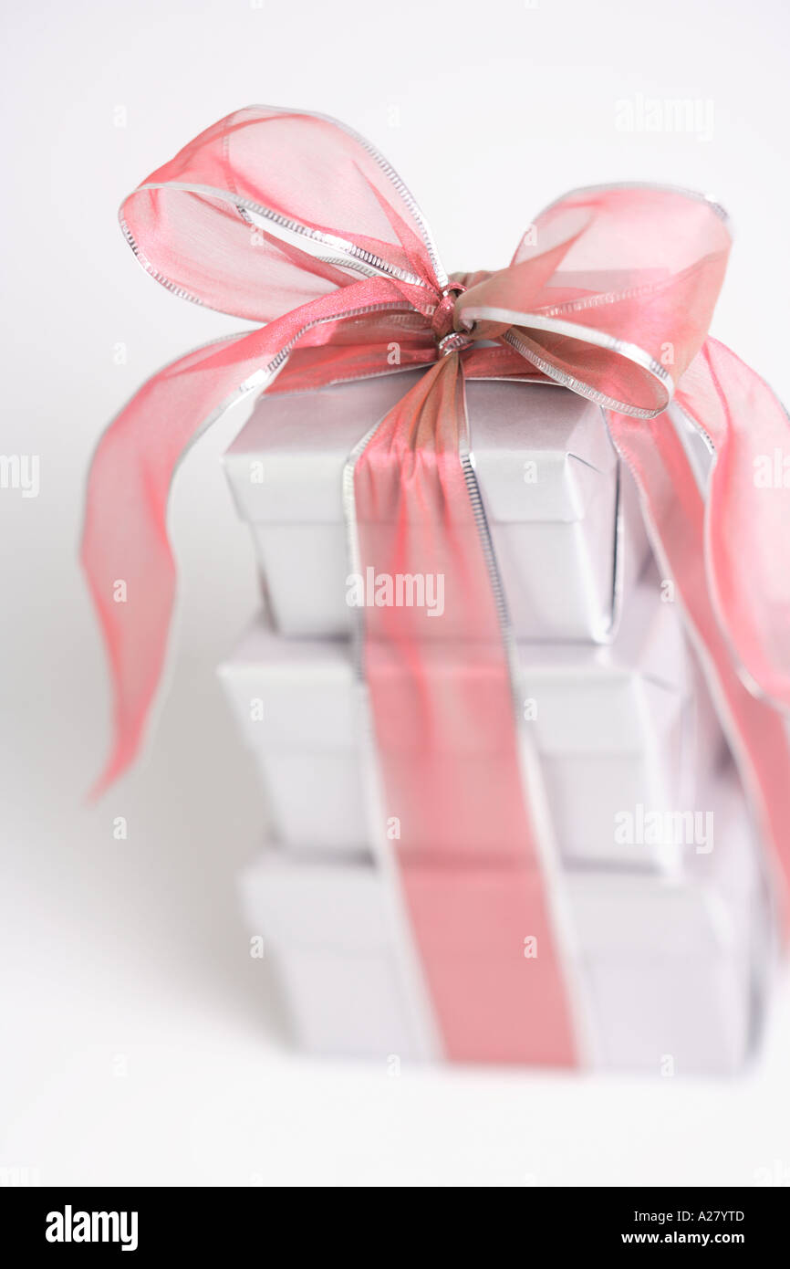 Stack of silver wrapped presents with a red bow Stock Photo: 5963724 ...