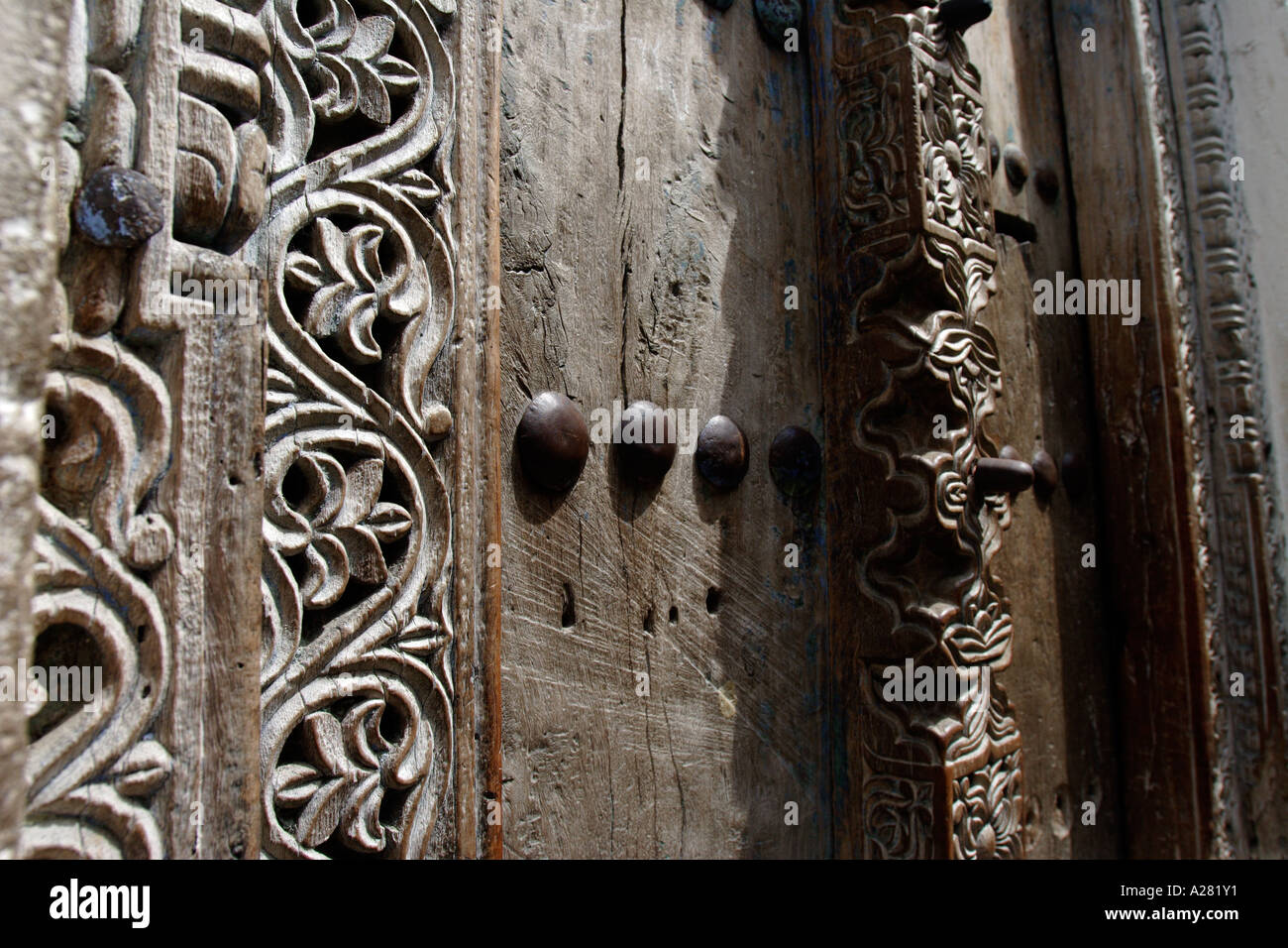 east africa tanzania island of zanzibar the beautiful doorways in stone town Stock Photo