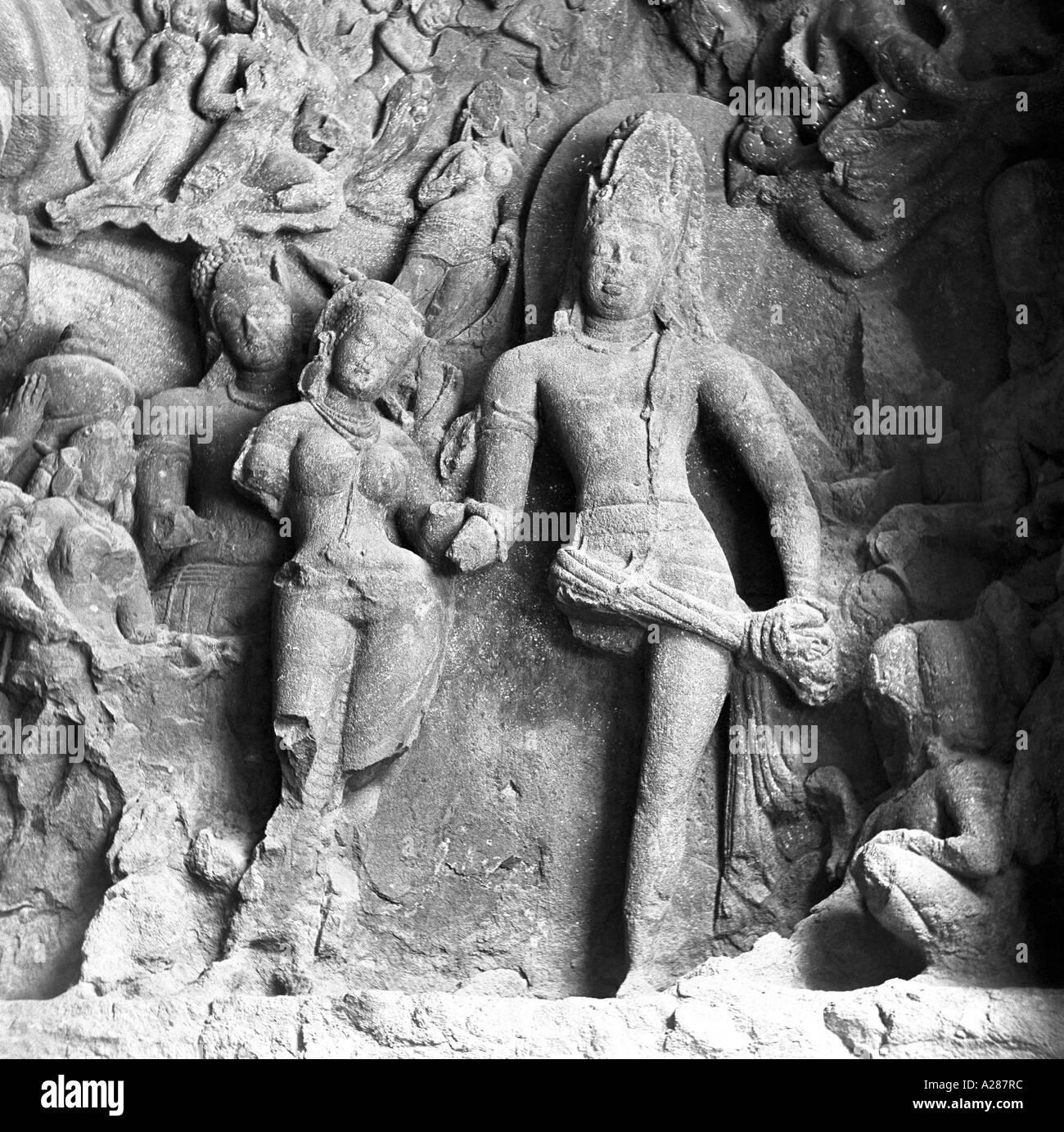 Shiva And Parvathi carved In stone Elephanta Caves Bombay Mumbai India - Stock Image