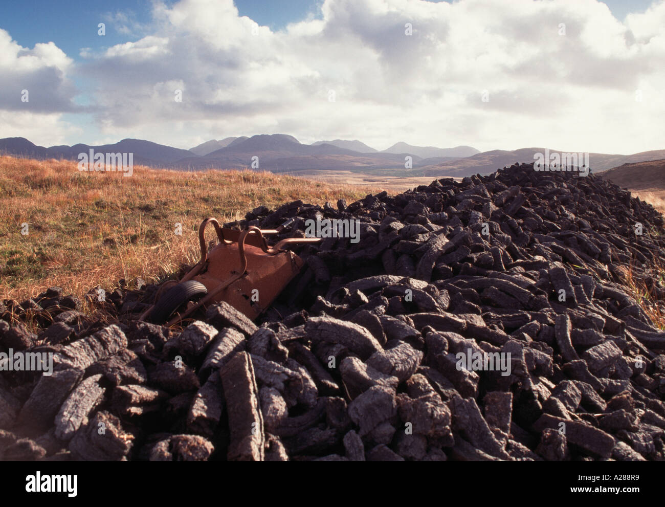 Upturned Wheel barrow on a pile of turf, Connemara, Galway, west of Ireland - Stock Image