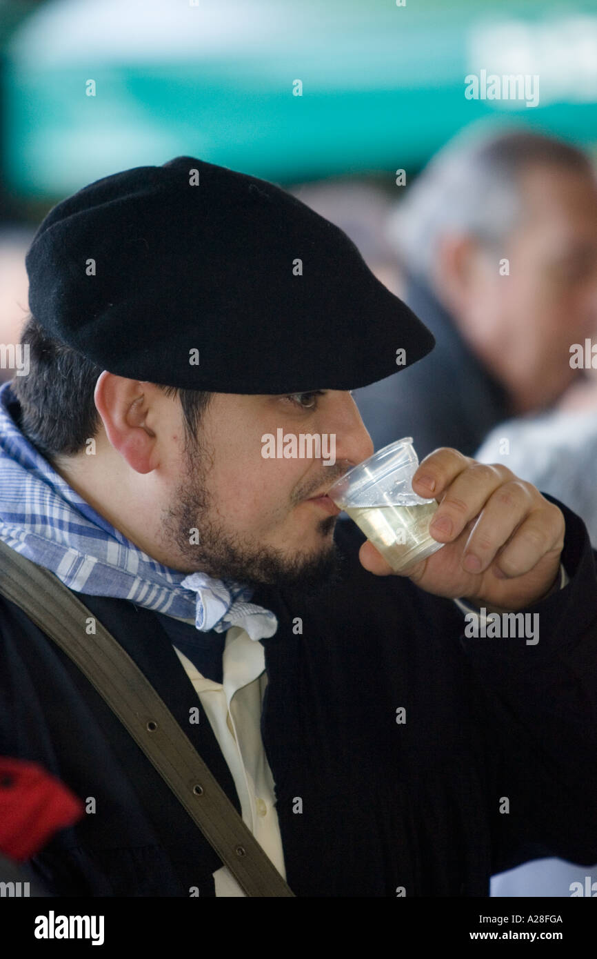ccff0a9e89d84 Man in traditional Basque dress wearing a black beret drinking txakoli at  the Santo Tomas (Saint Thomas) celebration Bilbao Spai
