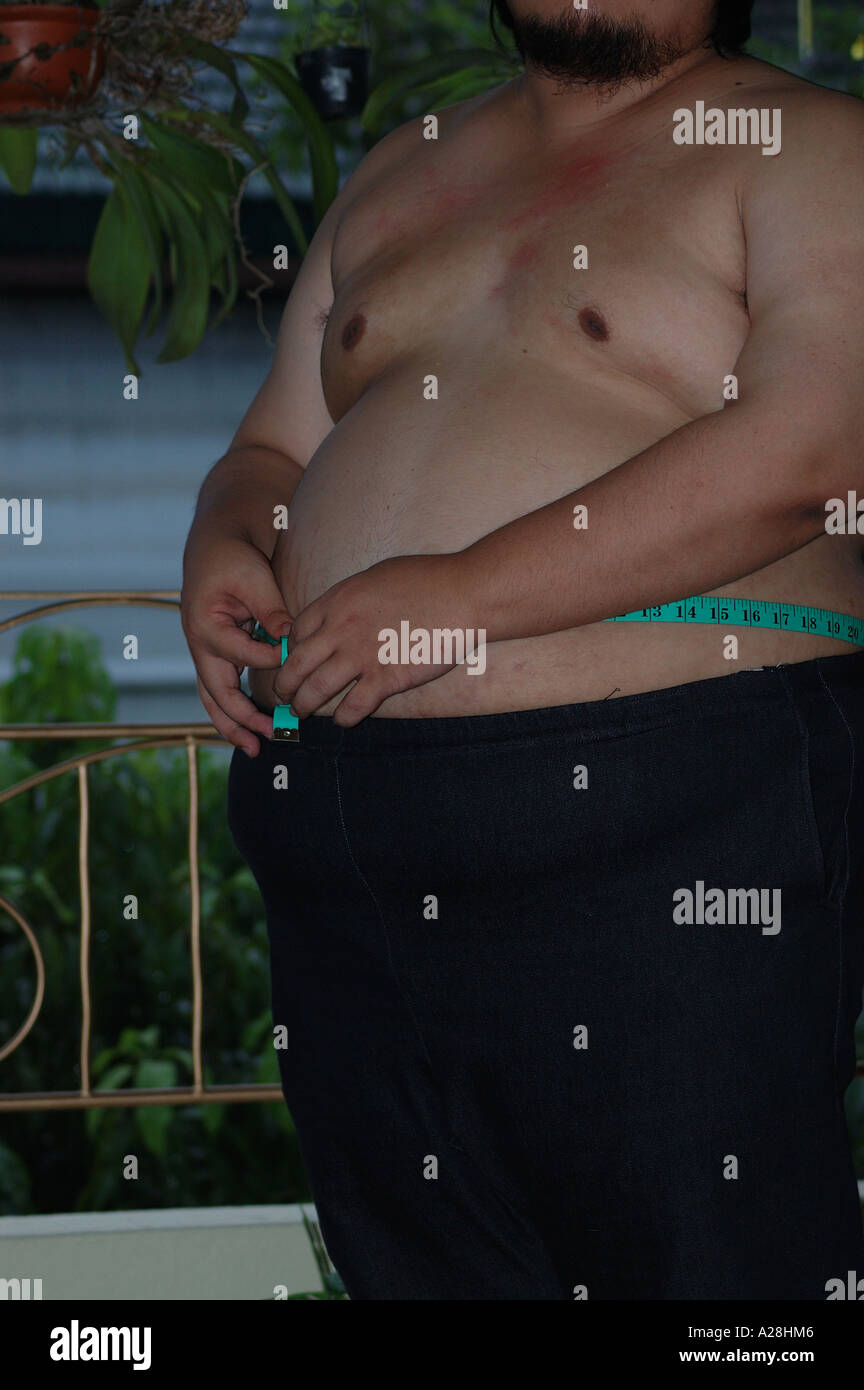 Man Measuring Size Of Tummy With Tape Stock Photo 5967109 Alamy