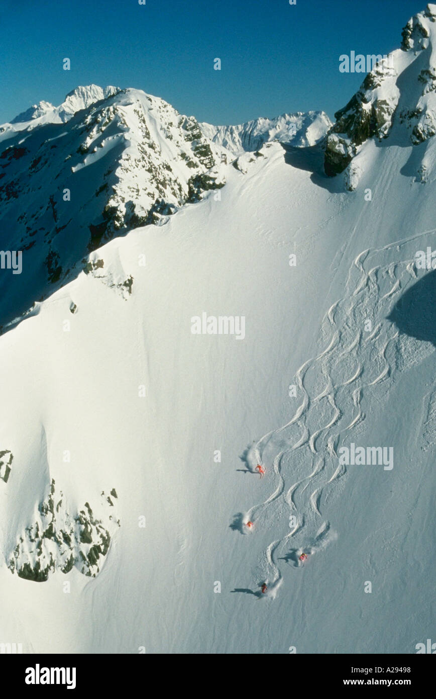 Helicopter skiing with the Alpine Guides in the Ragged Range of the Southern Alps near Christchurch New Zealand - Stock Image