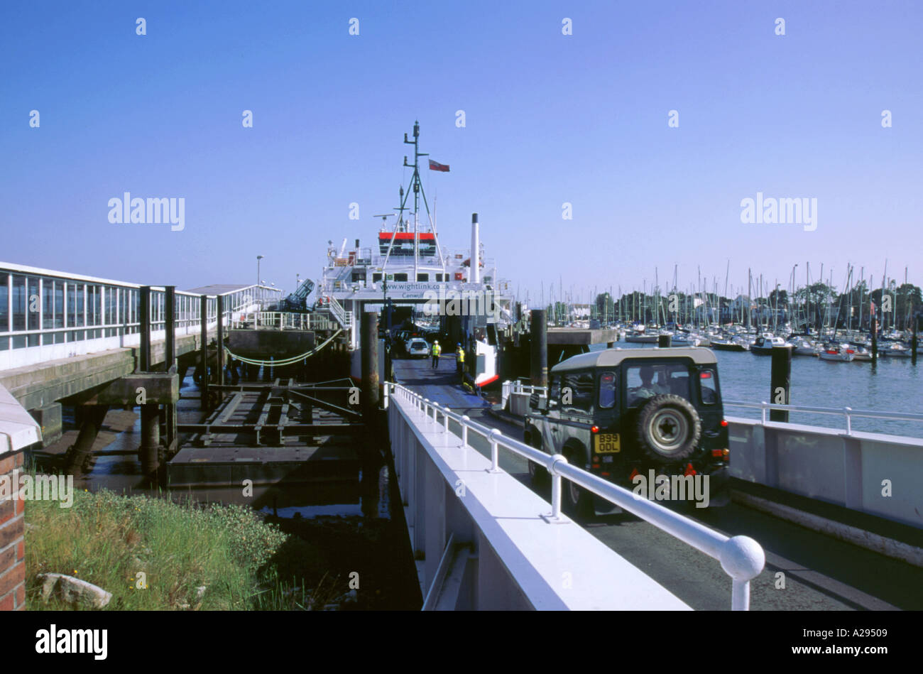 Cars boarding Lymington ferry bound for Isle of Wight - Stock Image