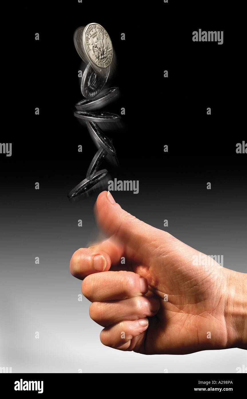 hand tossing Dollar coin - Stock Image