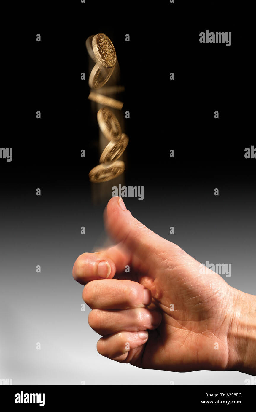 hand tossing Pound coin - Stock Image