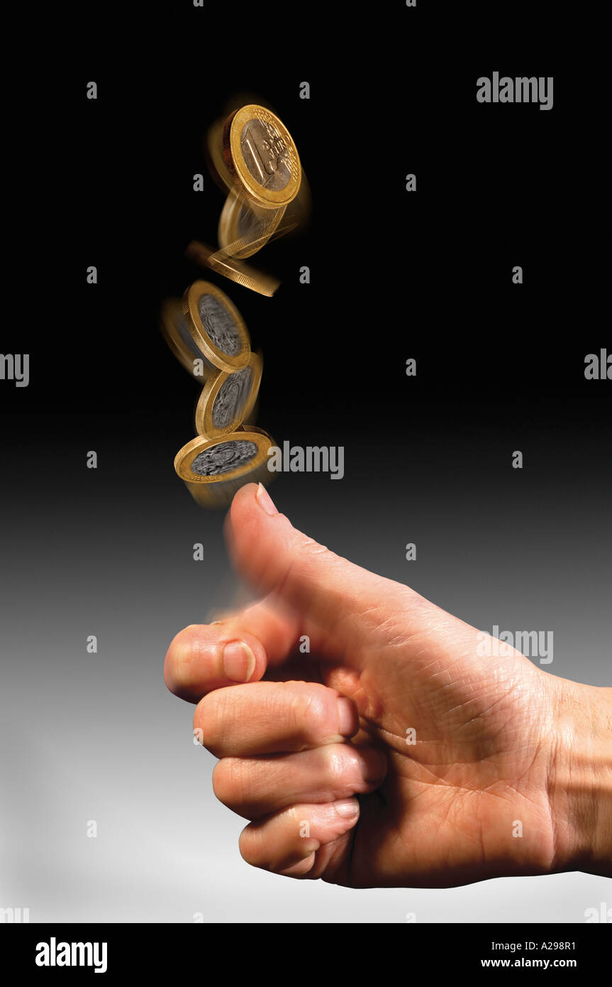 hand tossing Euro coin - Stock Image