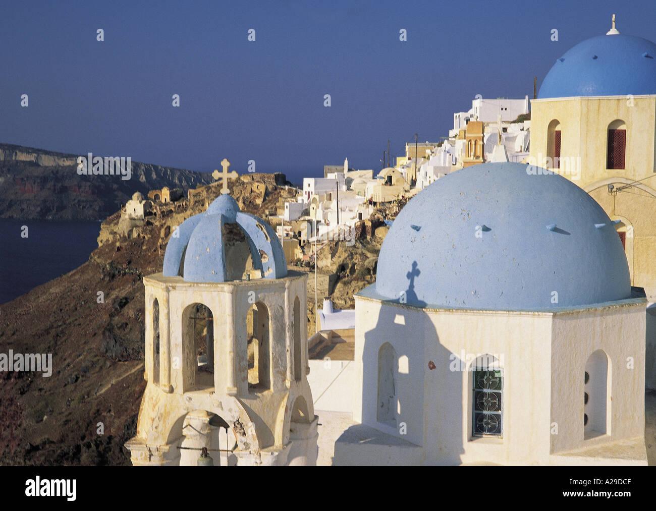 Santorini three blue cupolas Greece S Grandadam - Stock Image