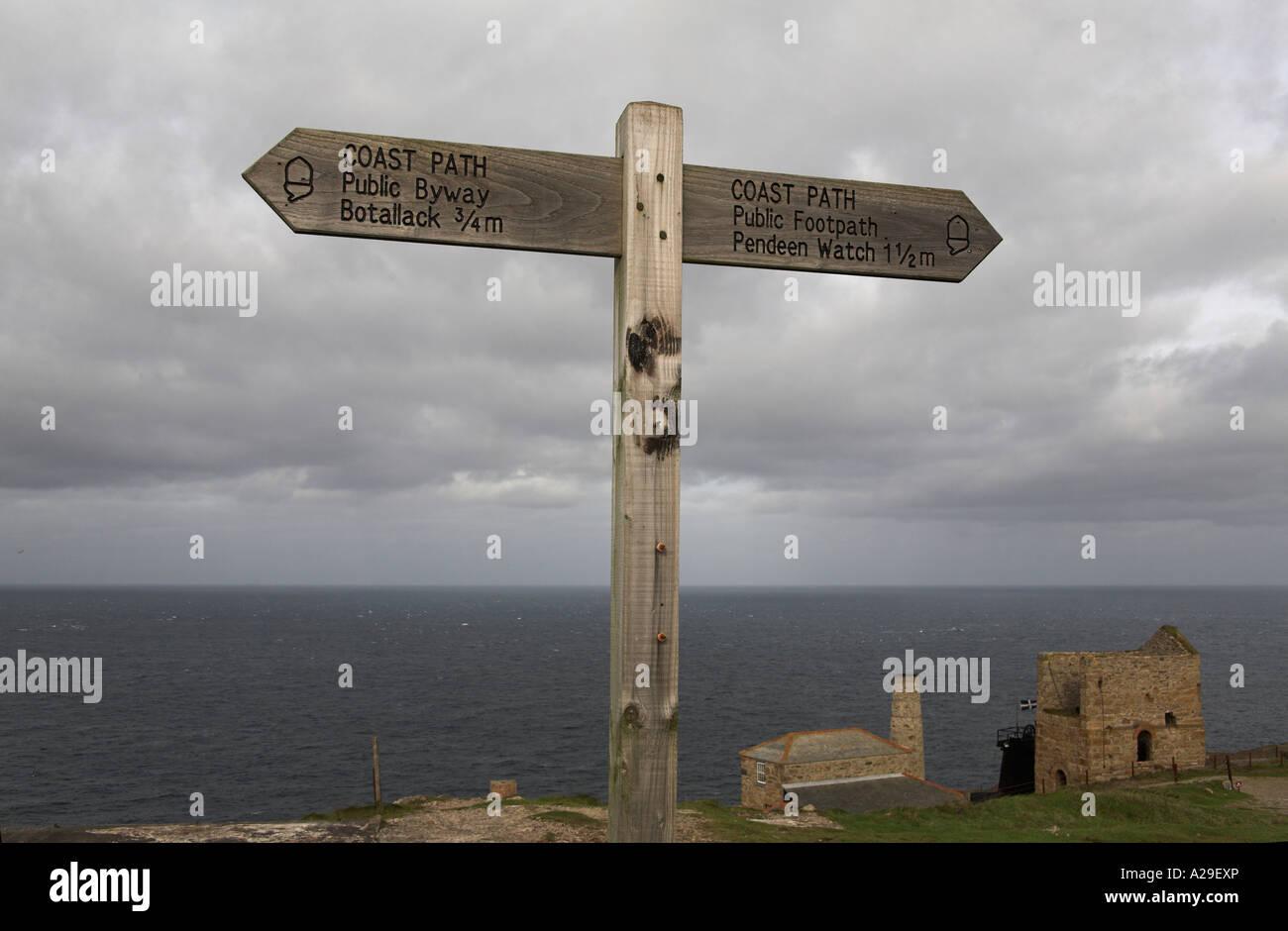 Southwest Coastal Footpath direction sign Levant Tin Mine Cornwall finger post - Stock Image