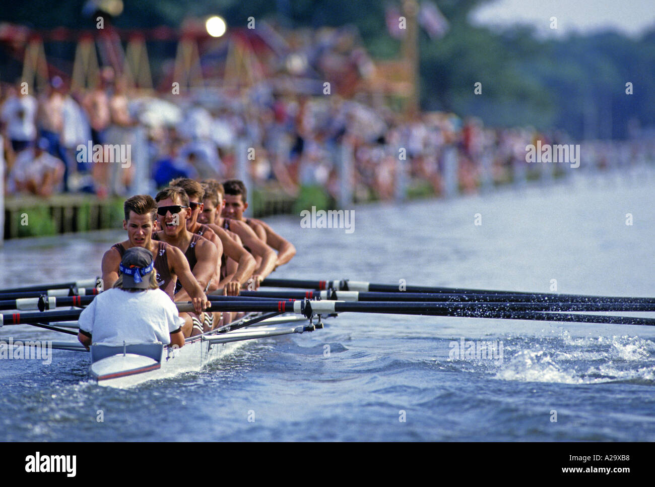 The crew of the coxed Eight from Brown University USA rowing in front of the crowd during a race at the Henley Royal Regatta - Stock Image