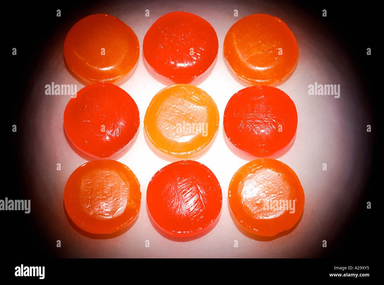 Orange lozenges, close-up, elevated view - Stock Image