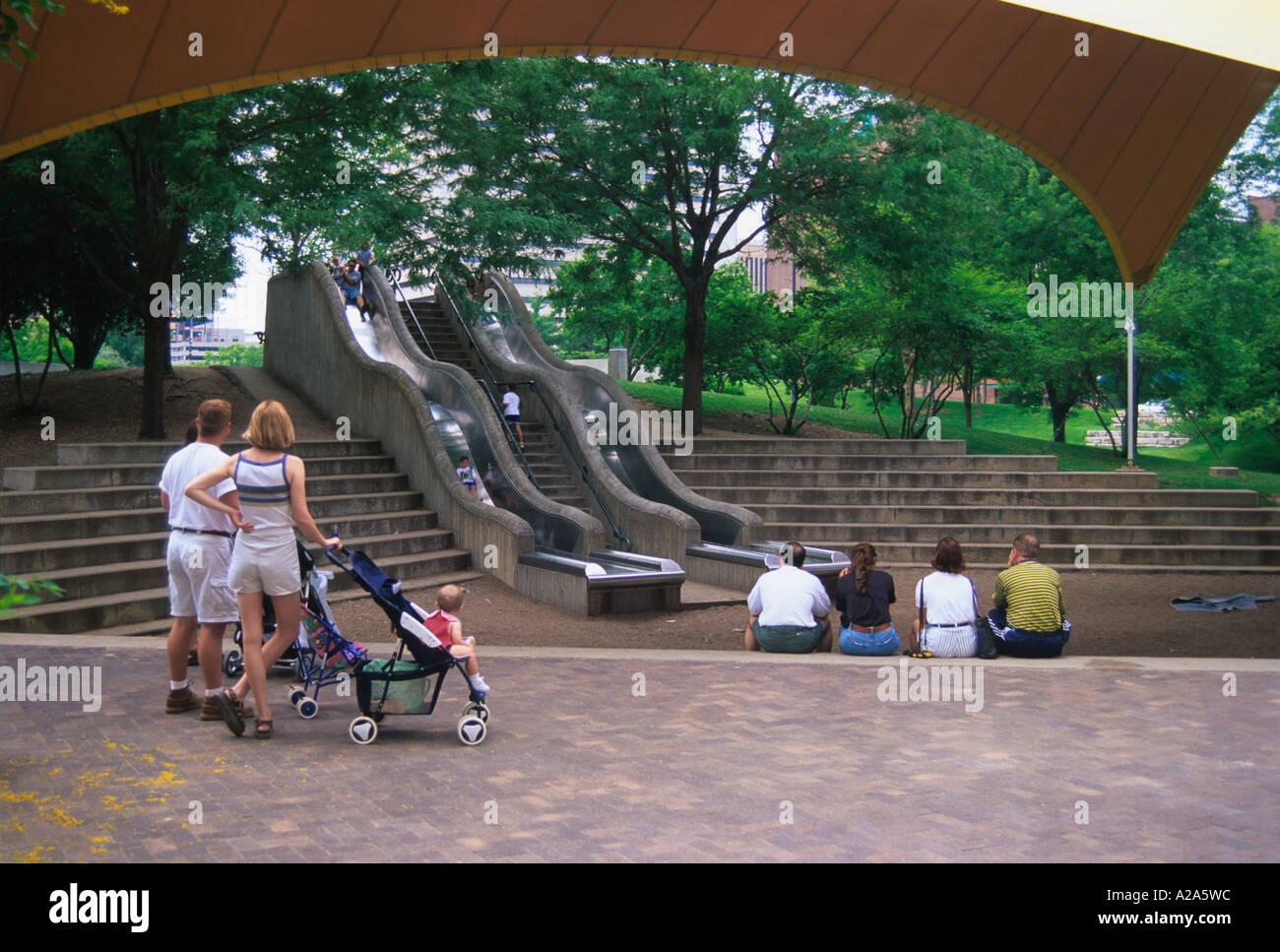 Children playing at a playground in the Gene Leahy Mall in downtown Omaha, Nebraska. Stock Photo