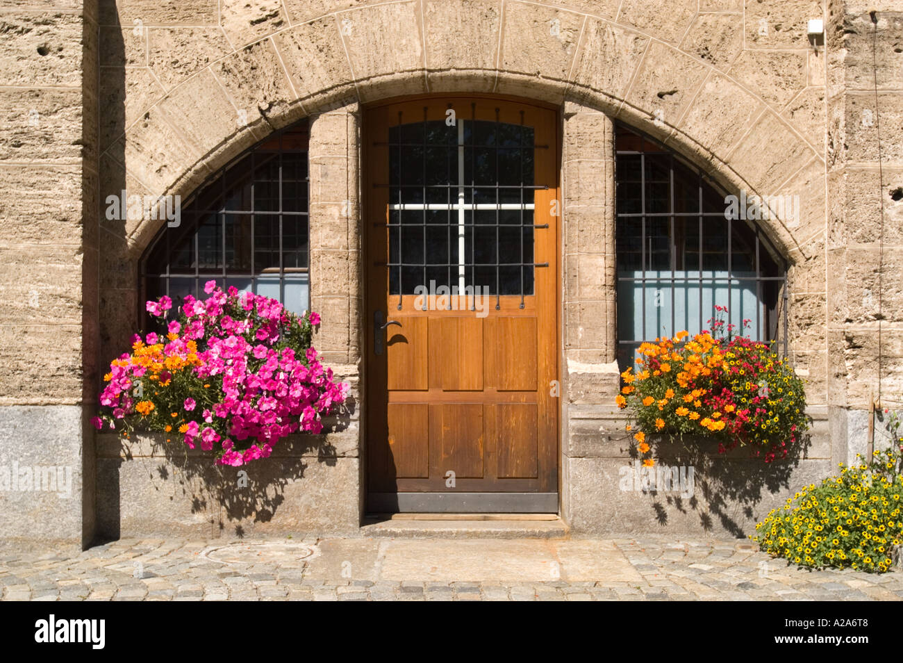 Window boxes frame a stone arched doorway in St. Moritz, Switzerland ...