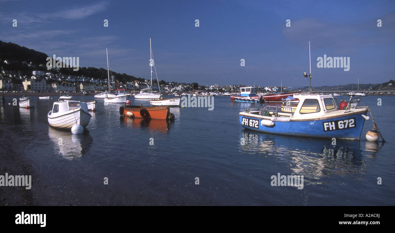 Small craft moored on the estuary of the River Teign at Teignmouth, South Devon. - Stock Image
