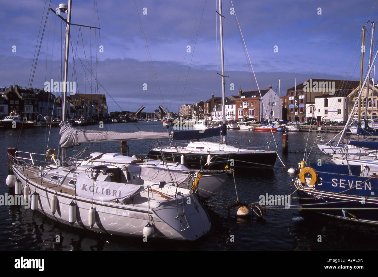 Yachts moored along the River Wey and in the harbour area at Weymouth, Dorset - Stock Image