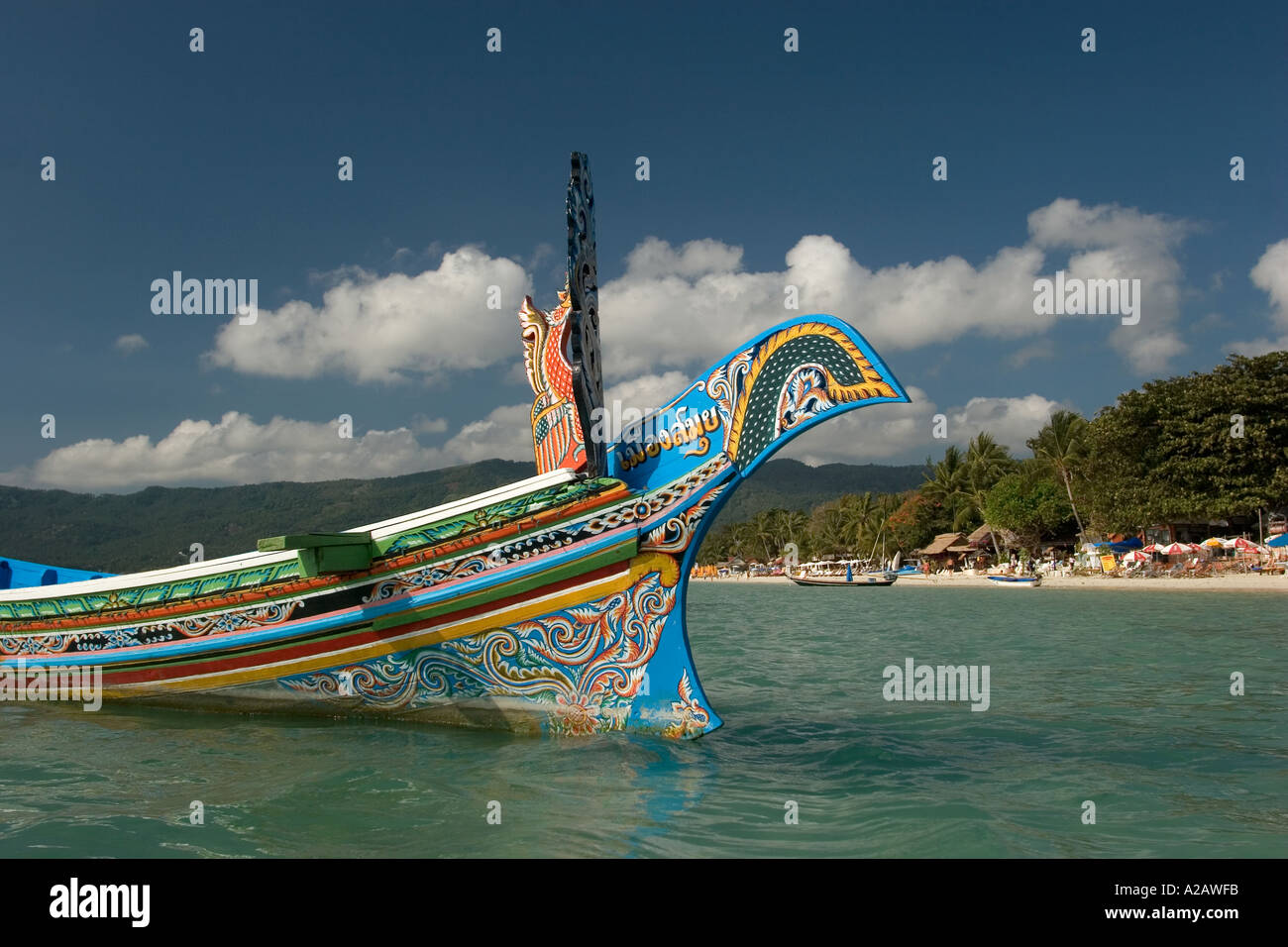 Thailand Ko Samui East Coast Chaweng beach prow of decoratively painted long tail boat and beach - Stock Image