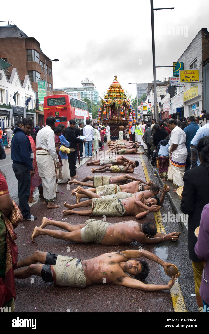 Men from Sri Kanaga Thurkai Amman Temple performing Piralheddai the annual Chariot Festival West Ealing London - Stock Image