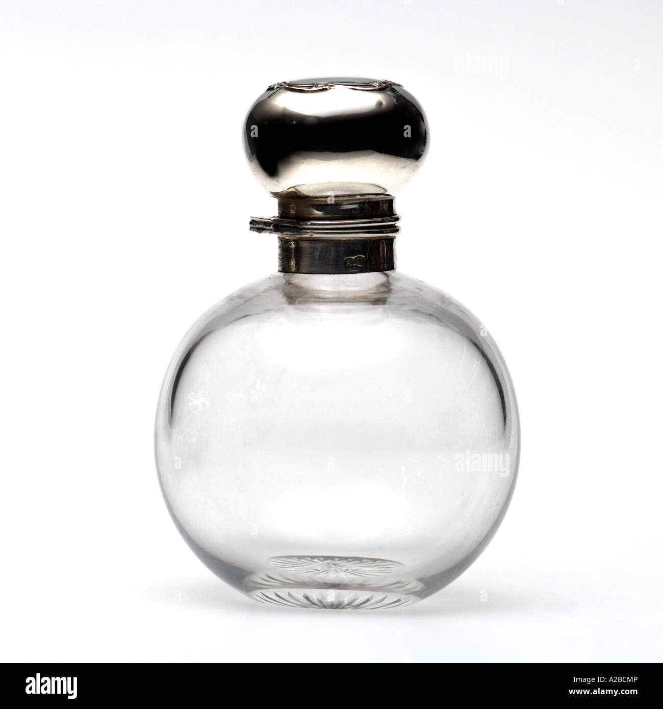 A Silver and Glass Perfume Bottle early 1900s - Stock Image