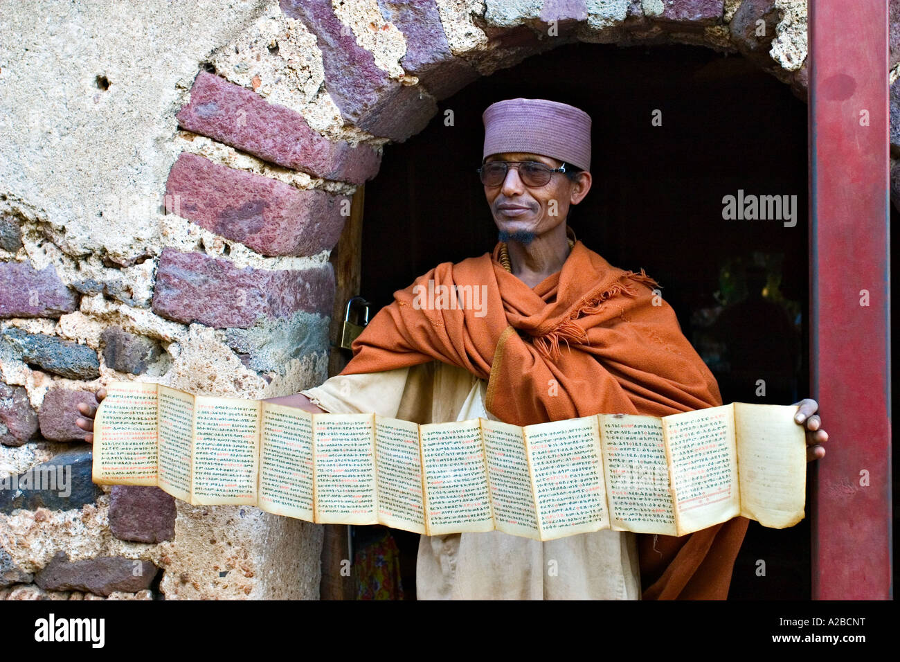 Ethiopian priest showing a scripture written in Amharic, Bahir Dar, Ethiopia, Africa - Stock Image