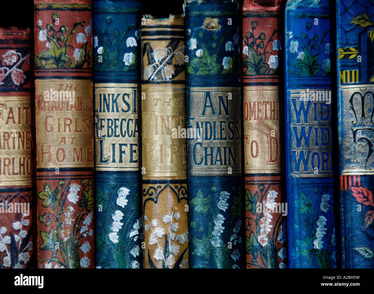 Old books antique Lilac Series Novels 1890s EDITORIAL USE ONLY - Stock Image