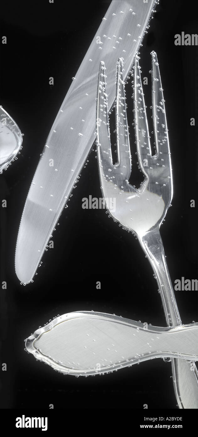 Silverware Underwater With Air Bubbles  - Stock Image